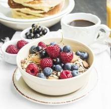Healthy Breakfast with Muesli and Raspberries,Blueberries,Currants, Coffee and Juice